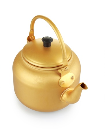 Gold kettle isolated on white background photo