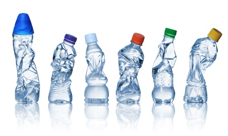 collection of empty used plastic bottles on white background. photo