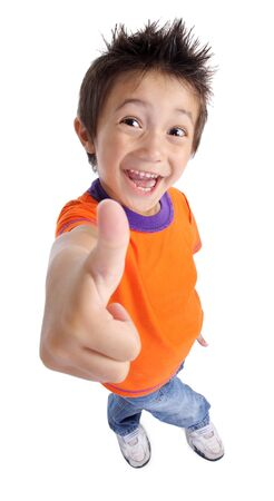 Portrait of a smilling cute little boy gesturing thumbs up sign agaist white background photo