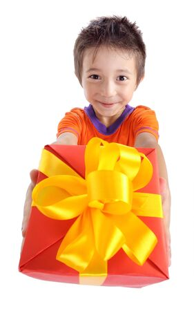 Little boy holding present box isolated on white photo