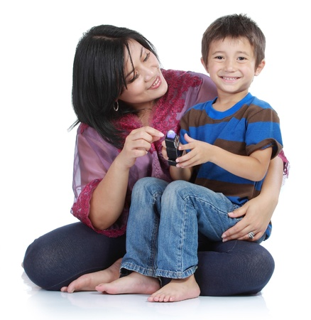 mother and son: young little son embracing his pretty young mother in isolated over white