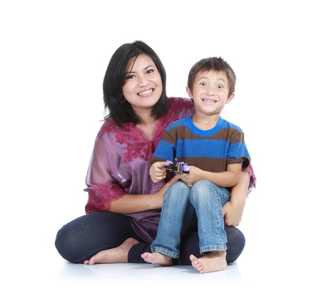Portrait of a beautiful happy mother with smiling boy isolated on white Stock Photo - 11682157