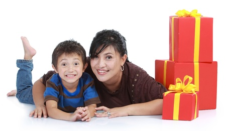 mom and kid with a stack of gift. isolated over white background photo