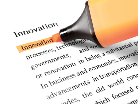 definition define: The word Innovation highlighted in orange with felt tip pen