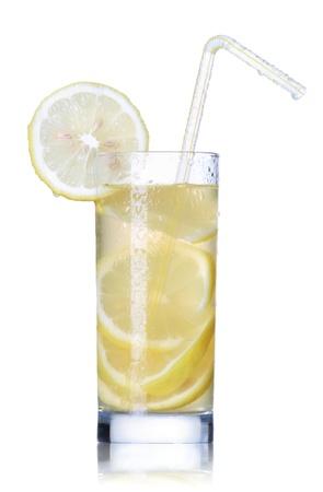 the carbonation: Fresh lemon juice with fruit slices isolated on white background