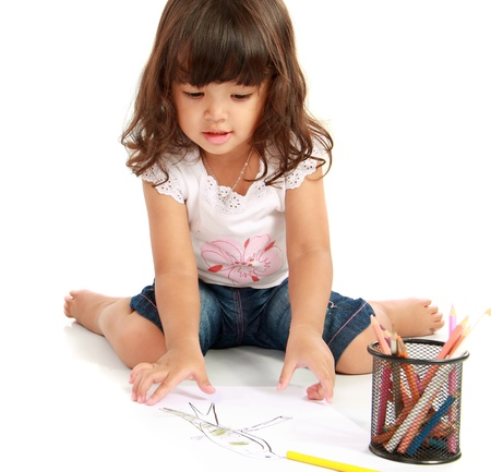 asian hair: little pretty girl drawing and coloring with pencil color on a white background