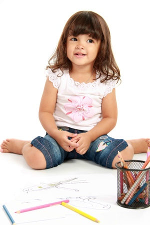 only girls: little cute girl smiling while draw with pencil color on a white background Stock Photo