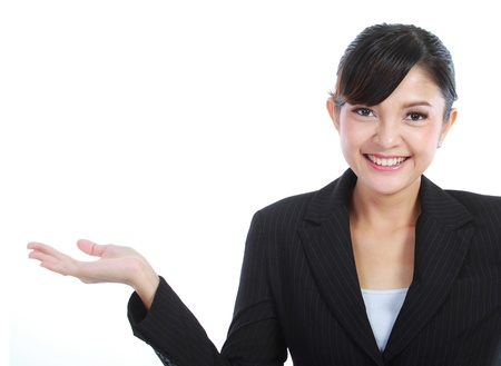 copyspase: smiling beautiful business woman showing blank area for sign or copyspase, isolated on white background