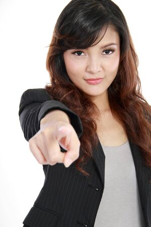 Portrait of a pretty young woman pointing at you over white background Stock Photo - 11847013