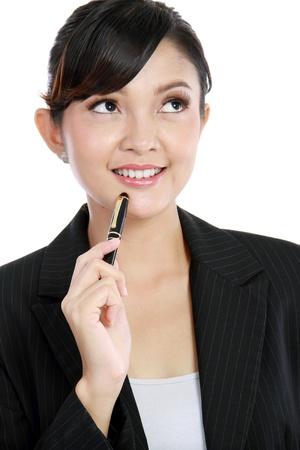 beautiful business woman thinking isolated on white background Stock Photo - 11846756