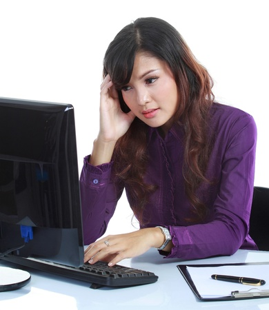 Portrait of beautiful business woman contemplating at office isolated over white Stock Photo - 11845953