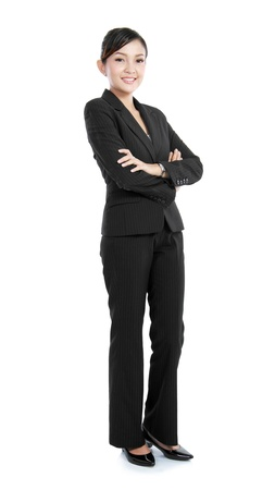 Happy smiling business woman in suit isolated on white background photo