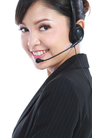Young beautiful customer service operator with headset on white background. photo