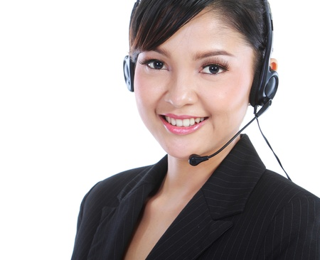 contact center: Young beautiful customer service operator with headset on white background. Stock Photo
