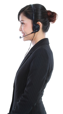 sales call: Side view of a young female customer service operator. in isolated over white background Stock Photo