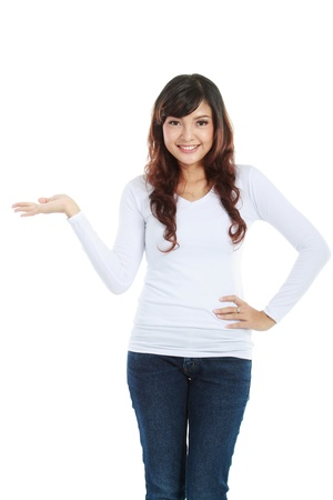 promotion girl: Portrait of smiling young woman showing a imaginary product on white background