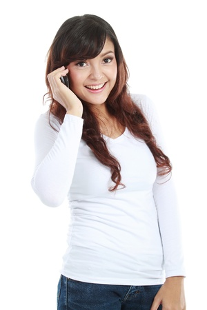 Young happy asian woman is calling with a mobile phone isolated on white photo