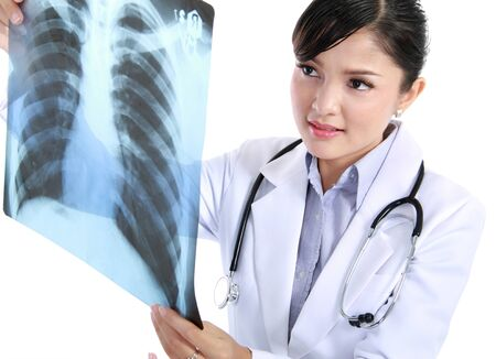 chest xray: A female doctor is checking x-ray - isolated on white background