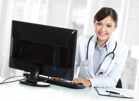 doctor computer: Beautiful medical doctor woman in the office