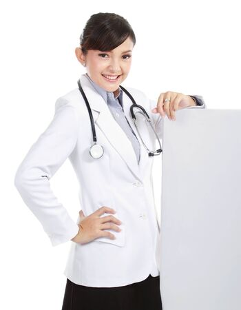 A smiling female doctor with a blankboard, isolated on white background photo