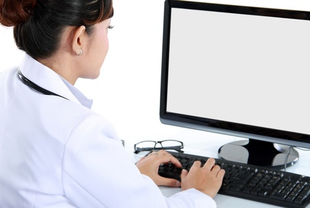 medical physician: medical doctor woman working with computer. Isolated over white background