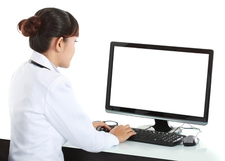 doctor computer: medical doctor woman working with computer. Isolated over white background