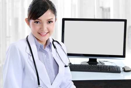 Beautiful medical doctor woman in the office photo