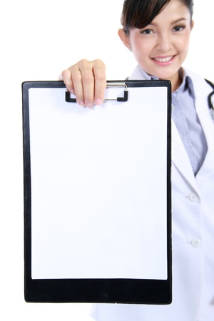 Woman doctor  Nurse showing blank clipboard sign - a medical concept. isolated on white background photo