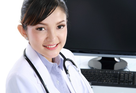 doctor woman sitting on her office with computer set isolated over white photo