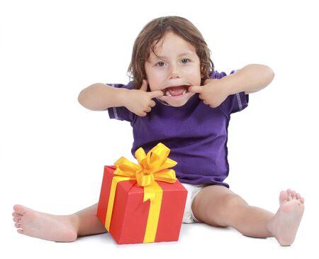 Joyful boy with present box . Isolated on white background Stock Photo - 11844304