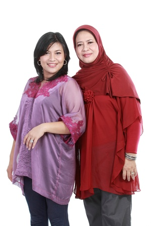 muslim woman with her daughter isolated over white backround photo