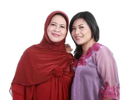 east asian ethnicity: muslim woman with her daughter isolated over white backround