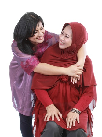 headscarf: muslim woman with her daughter isolated over white backround