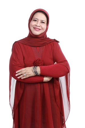 Confident Muslim woman in scarf, isolated over white background photo
