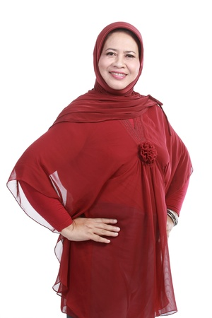 liberated: Confident Muslim woman in scarf, isolated over white background