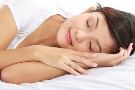 lovely young female sleeping on the bed photo