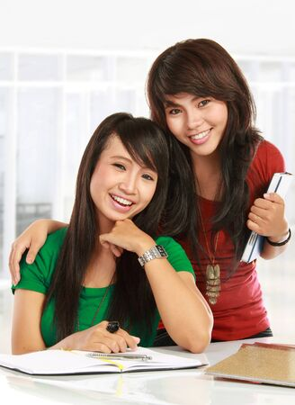 Portrait of a two young students smiling Stock Photo - 11846420