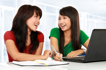 class room: portrait of two young asian student smiling