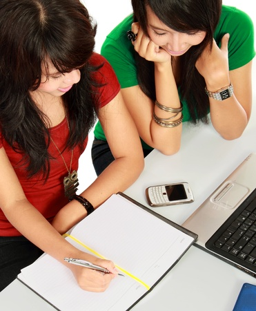 studygroup: top view portrait of two young asian student studying