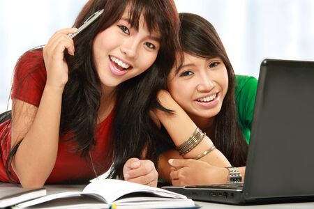 two young attractive female student smiling looking to the camera Stock Photo - 11846343
