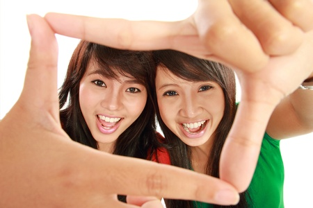 two happy woman posing for a photo isolated over white background Stock Photo - 11845814