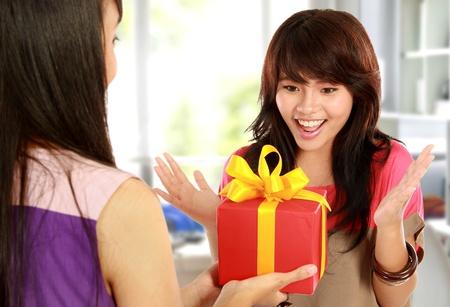 portrait of young woman having surprise present photo