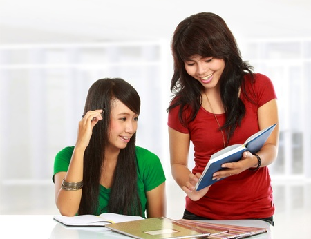 studygroup: portrait of two young asian student studying in class room Stock Photo