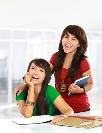 studygroup: Portrait of a young asian students smiling to the camera