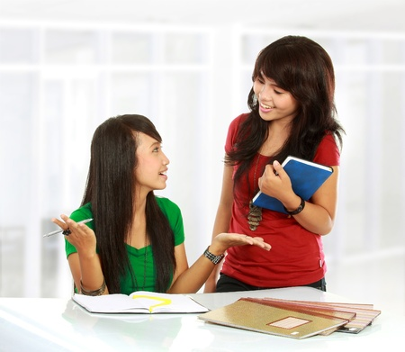 student desk: Portrait of a young students having a discussion in the class room