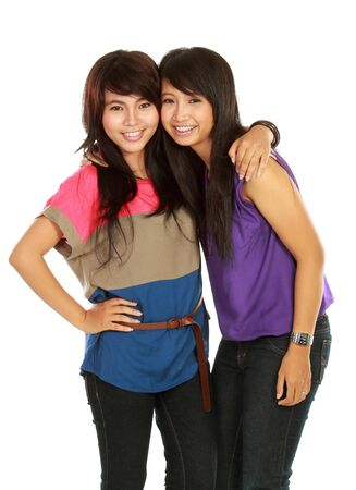 portrait of attractive two girls smiling to the camera isolated on white background photo