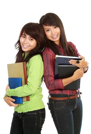 Portrait of a two young students holding a book isolated on white background photo