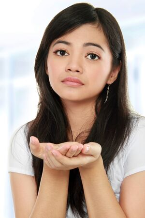 close up portrait of young beautiful woman begging for something Stock Photo - 12004832