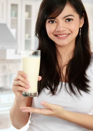 health drink: Girl having a glass of milk