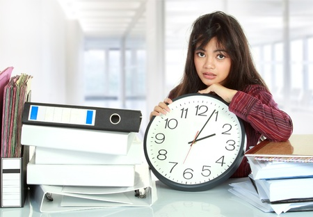 young business woman with many paper work and big clock stressed at work Stock Photo - 12004778
